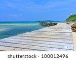 Wood Jetty In Thai Sea