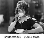 portrait of woman drinking from ... | Shutterstock . vector #100115036