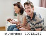 young man playing on console... | Shutterstock . vector #100121252