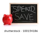 Piggy bank with blackboard and words spend and save - stock photo