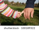 a parent holding the hand of... | Shutterstock . vector #100189322