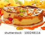 homemade cheese cake with raisins and candied orange peel poured chocolate for easter - stock photo