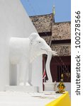 white elephants sculpture on pagoda wall - stock photo
