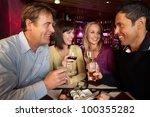 group of friends enjoying sushi ... | Shutterstock . vector #100355282