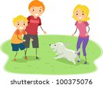 Illustration of a Family Playing with Their Dog - stock vector