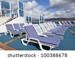 Roe of striped deck chairs on sundeck of the cruise ship on sunny day - stock photo