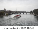 navigation on Seine River on a cloudy day, Paris, France - stock photo