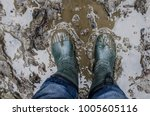 rubber boots in the mud. man... | Shutterstock . vector #1005605116