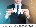 businessman hands connecting... | Shutterstock . vector #1005619942