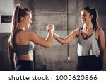 two young muscular smiling girl ...   Shutterstock . vector #1005620866