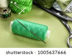 spool of sewing thread with... | Shutterstock . vector #1005637666