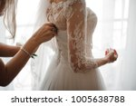 bridesmaid making a bow knot on ... | Shutterstock . vector #1005638788