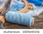 spool of sewing thread with... | Shutterstock . vector #1005640156