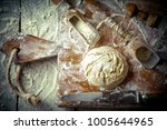 dough with flour on an old... | Shutterstock . vector #1005644965