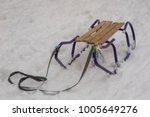 sledges on the snow. children's ... | Shutterstock . vector #1005649276