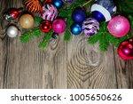 christmas balls lie on fir... | Shutterstock . vector #1005650626
