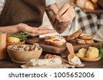 woman preparing delicious... | Shutterstock . vector #1005652006