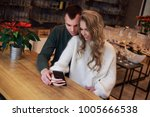 a couple is having a date. they ... | Shutterstock . vector #1005666538