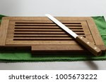 bread board with knife | Shutterstock . vector #1005673222