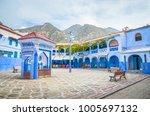 beautiful street of blue medina ... | Shutterstock . vector #1005697132