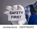 close up of workman hands with... | Shutterstock . vector #1005700492