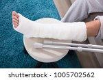 elevated view of man's broken... | Shutterstock . vector #1005702562