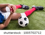 close up of an injured male... | Shutterstock . vector #1005702712