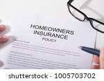 close up of homeowners... | Shutterstock . vector #1005703702