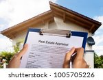 person filling real estate... | Shutterstock . vector #1005705226