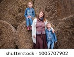family   mother and two... | Shutterstock . vector #1005707902
