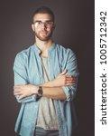 portrait of a happy casual man... | Shutterstock . vector #1005712342