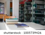 textbooks on table in library...   Shutterstock . vector #1005739426