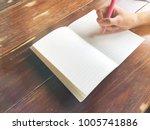 hand hold pen writing on blank...   Shutterstock . vector #1005741886