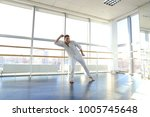 male person dancing in tectonic ... | Shutterstock . vector #1005745648