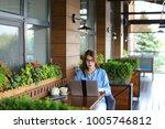 pretty female student working...   Shutterstock . vector #1005746812