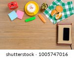 wooden table with notebook...   Shutterstock . vector #1005747016