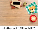 wooden table with notebook...   Shutterstock . vector #1005747082