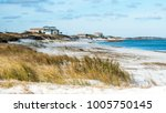 beach front houses at the coast ... | Shutterstock . vector #1005750145