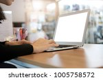 side view woman hands using...   Shutterstock . vector #1005758572