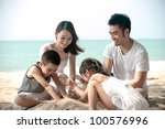 happy asian family playing on... | Shutterstock . vector #100576996