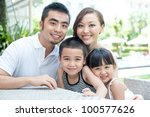 Attractive Asian Family Outdoo...