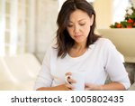 mature unhappy woman. | Shutterstock . vector #1005802435