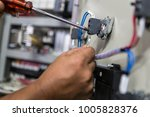 hand of electrician with... | Shutterstock . vector #1005828376