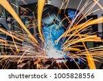 industrial worker is welding... | Shutterstock . vector #1005828556