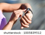 woman using smartwatch touching ... | Shutterstock . vector #1005839512
