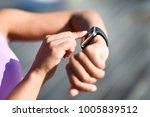 woman using smartwatch touching ...   Shutterstock . vector #1005839512
