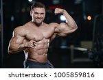 brutal sexy strong bodybuilder... | Shutterstock . vector #1005859816
