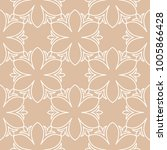 white floral design on beige... | Shutterstock .eps vector #1005866428
