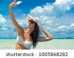 beautiful woman at the beach in ... | Shutterstock . vector #1005868282