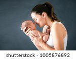 young mother  kissing and... | Shutterstock . vector #1005876892